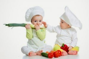 babies boy and girl with healthy  food vegetables